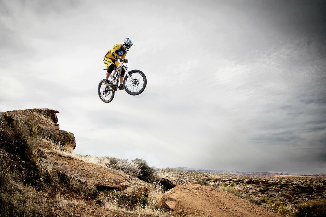A mountain biker in mid-jump