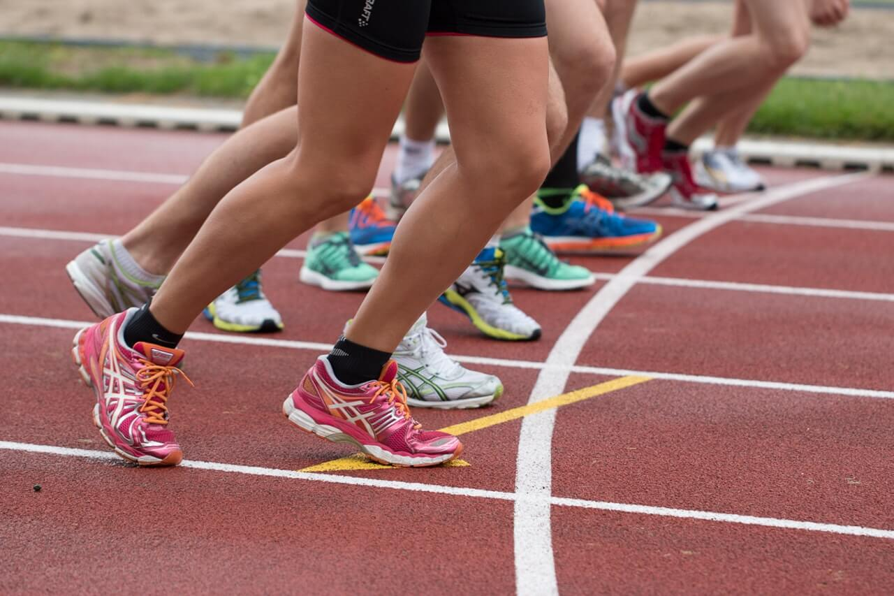 Colourful shoes at starting line of race track